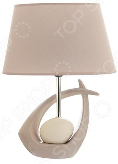 Лампа настольная Elan Gallery «Мелодия»Настольные лампы<br>Лампа настольная Elan Gallery Мелодия электрический светильник для освещения дома и придания помещению особого уюта, атмосферы, чтобы подчеркнуть красоту интерьера. Придаст домашним вечерам особое очарование. Лампа выполнена в оригинальном стиле, идеально подойдет как подарок на новоселье. Светильник в современном стиле прекрасно подойдет для гостиной и спальни.  Овальный абажур.  Оригинально смоделированное основание. На сегодняшний день существует множество вариантов того, как украсить интерьер с помощью красивых настольных ламп. Комбинируйте сразу несколько декоративных элементов и придавайте индивидуальность и неповторимость любому помещению.<br>