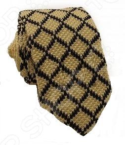 Галстук Mondigo 32014 это стильный мужской вязанный галстук. Галстук давно стал неотъемлемым аксессуаром мужского гардероба. Многие мужчины, предпочитающие костюмы или же вынужденные носить их по долгу службы, знают, что галстук это способ придать индивидуальности. Правильно подобранный галстук может многое рассказать о его владельце: о вкусе, пристрастиях и характере мужчины. Галстук сделан из качественного материала, который хорошо держит узел.