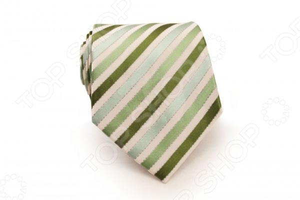 Галстук Mondigo 44256Галстуки. Бабочки. Воротнички<br>Галстук Mondigo 44256 - элегантный мужской галстук, выполненный из шелка, который обладает хорошими гигиеническими свойствами и особым блеском. Галстук темно-зеленого цвета, украшен диагональными полосами средней толщины. Края галстука обработаны лазерным методом. Такой стильный галстук будет очаровательно смотреться с мужскими рубашками темных и светлых оттенков. Необычный дизайн дополнит деловой стиль и придаст изюминку к образу строгого делового костюма.<br>