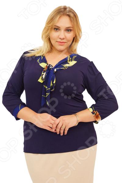 Блуза Матекс «Валентина». Цвет: желтыйБлузы. Рубашки<br>Блуза Матекс Валентина незаменимая вещь в гардеробе модницы. Подойдет для женщин практически любой комплекции, ведь особенности кроя помогают скрыть недостатки и подчеркнуть достоинства фигуры. Эта блуза полуприталенного силуэта отлично подойдет для повседневного использования.  Удобная длина на уровне бедра будет идеально смотреться на женщинах с любым типом фигуры и любого возраста.  Выразительный фасон позволяют надеть ее не только в офис или на прогулку, но и на официальные мероприятия.  V-образный вырез горловины украшен галстуком.  Галстук выполнен из яркого цветочного принта.  На фото с юбкой Венера . Блуза изготовлена из высококачественного трикотажа 95 вискоза, 5 полиэстер . Полиэстер предохраняет вещь от измятия и быстро высыхает после стирки. Швы обработаны текстурированными, эластичными нитями, благодаря чему не тянутся и не натирают кожу.<br>