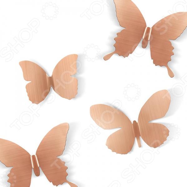 Декор для стен Umbra Mariposa 9 - добавит в ваш интерьер легкости и веселого настроения. В комплект входят 9 летящих бабочек, которые помогут превратить любую, даже самую скучную, стену в декоративное пространство. Комплект отлично подойдет для украшения спальни, гостиной или детской комнаты. Бабочки крепятся с помощью специального двухстороннего скотча, который не оставляет следов.
