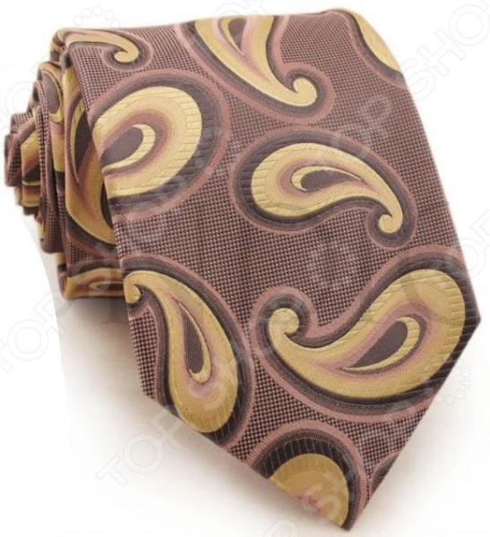 Галстук Mondigo 44222Галстуки. Бабочки. Воротнички<br>Галстук Mondigo 44222 завершающий штрих в образе солидного мужчины. Сегодня классический стиль в одежде приветствуется не только на работе в офисе. Многие люди предпочитают в качестве повседневной одежды костюм или рубашку с галстуком. Мужчина, выбирающий такой стиль в одежде, всегда выделяется среди окружающих и производит положительное первое впечатление. Кроме того, один и тот же галстук можно носить по-разному каждый день. Достаточно выбрать один из многочисленных типов узлов: аскот, балтус, кент, пратт и многие другие. Кстати, в интернете есть сайты, которые случайным образом предлагают вариант узла удобно, когда трудно определиться с выбором . Галстук изготовлен из шелка. Ткань довольно прочная, приятная на ощупь и отличается роскошным блеском. С обратной стороны галстук прострочен шелковой ниткой, что позволяет регулировать длину изделия.<br>