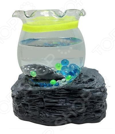 Мини-аквариум декоративный 31 век Черепаха оригинальное украшение домашнего или офисного интерьера. Обитатель аквариума ведет себя словно настоящий, хотя сделан из водонепроницаемого пластика. Секрет внутри подставки в виде скалы. Там спрятан магнит, который действует на меньшие магниты внутри черепашки, создавая эффект перемещения в воде. Питание осуществляется от 2 батареек типа AA приобретаются отдельно .