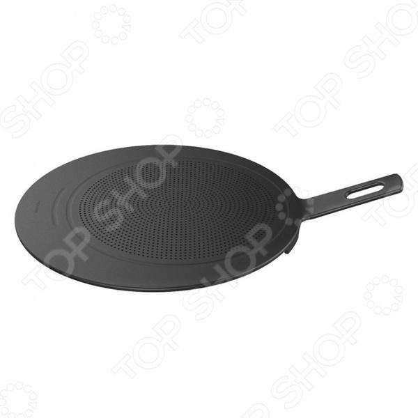 Крышка для жарки Fiskars Functional Form 1014348 с перфорированной поверхностью подойдет для использования со сковородками диаметром до 40 см. Изделие защищает от брызг масла и сохраняет тепло, что позволяет ускорить процесс приготовления блюда. Крышка оснащена удобной боковой ручкой с отверстием для подвешивания. Изготовлено из армированного стекловолокном нейлона и силикона. Допускается мытье в посудомоечной машине.