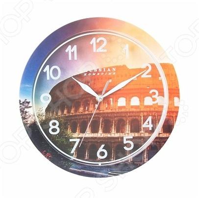 Часы настенные Вега П 1-268/7-268 «Колизей»Часы настенные<br>Настенные часы это элегантный и неотъемлемый элемент дизайна любого помещения. Правильно подобранные часы позволяют внести в общий интерьерный ансамбль некоторую изюминку и легкий штрих индивидуальности, собственного стиля. Поэтому к подбору такого значимого и функционального украшения надо подходить с умом. Настенные часы от бренда Вега настоящей находкой для тех, кто следит за трендами современной моды. Часы настенные Вега П 1-268 7-268 Колизей отлично впишутся в интерьер вашей гостиной, спальни, кухни или детской комнаты. Корпус кварцевых часов выполнен из качественного пластика, который гарантирует не только их легкость, но и практичность, легкий монтаж и уход. Циферблат данной модели оформлен стильным, ярким фото с впечатляющим ракурсом на один из самых знаменитых памятников архитектуры Колизей. Эксклюзивный дизайн изделия позволит подчеркнуть оригинальность интерьера вашего дома и выразить вашу индивидуальность, а яркая и сочная расцветка превратит часы в настоящий источник хорошего настроения и вдохновения.<br>
