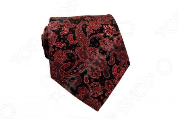 Галстук Mondigo 44285Галстуки. Бабочки. Воротнички<br>Галстук Mondigo 44285 это стильный аксессуар, необходимый для создания элегантного вида. Галстук ручной работы из шелка высокого качества, украшен изящным узором пейсли. С обратной стороны галстук прострочен шелковой ниткой. Края обработаны лазером и практически не видны. Такой галстук дополнит наряд в классическом стиле. Отлично подойдет для официального мероприятия. С этим галстуком вы сможете привлечь взгляды, и обратить на себя должное внимание.<br>
