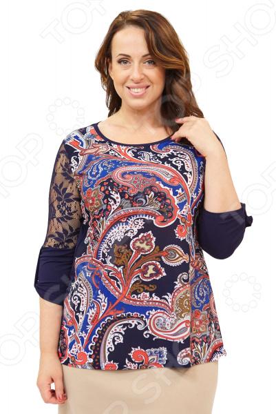 Блуза Матекс «Элина». Цвет: мультиколорБлузы. Рубашки<br>Блуза Матекс Элина это легкая и нежная блуза, которая поможет вам создавать невероятные образы, всегда оставаясь женственной и утонченной. Благодаря отличному дизайну она скроет недостатки фигуры и подчеркнет достоинства. Блуза прекрасно смотрится с брюками и юбками, а насыщенный цвет привлекает взгляд. В этой блузе вы будете чувствовать себя блистательно как на работе, так и на вечерней прогулке по городу. Свободный крой и универсальная длина на уровне бедра делают блузу одеждой на все случаи жизни, а удобные короткие рукава скрывают полноту плеч. Рукава выполнены из кружева, манжеты из однотонного трикотажа с декоративными защипами. Вырез горловины лодочка визуально удлинит горло, подчеркнет плавность черт и украсит область декольте. На фотографиях блуза представлена с юбкой Эшли . Перед из мягкого и принтованного трикотина, спинка однотонная 95 вискоза, 5 полиэстер, вставки: 100 полиэстер , благодаря чему материал не скатывается и не линяет после стирки. Кружево на рукавах не тянется.<br>