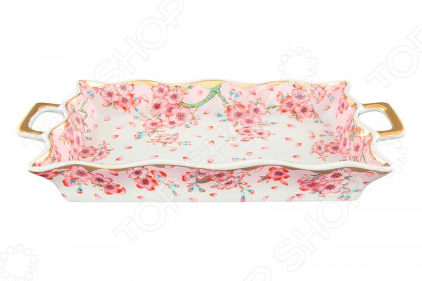 Хлебница Elan Gallery «Сакура»Хлебницы<br>Хлебница Elan Gallery Сакура для подачи хлебобулочных изделий к столу. Модель выполнена в эксклюзивном дизайне, снабжена ручками для удобной переноски. Сделана из керамики безопасного и экологически чисто материала, который не впитывает запахи и не меняет вкус изделия. Имеет подарочную упаковку. Для ухода не рекомендуется применять абразивные моющие средства.<br>
