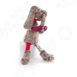 Мягкая игрушка Trudi Заяц АвгустинМягкие игрушки<br>Игрушка мягкая Trudi Заяц Августин это замечательный подарок вашему малышу! Игрушка изготовлена из сшитых друг с другом кусочков высококачественных гипоаллергенных материалов, которые абсолютно безвредны для ребенка. Забавный зверек со смешными руками и длинными ушами украсит любую детскую комнату и принесет радость и веселье во время игр. Trudi Заяц Августин поможет развить тактильные навыки, зрительную координацию и мелкую моторику рук. Изделие можно стирать в стиральной машинке при температуре не выше 30 градусов.<br>