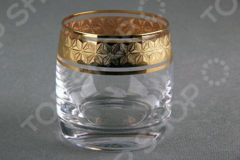 Набор стаканов Коралл Снежная королева оригинальный комплект, который идеально подойдет для сервировки праздничного стола. Изысканное исполнение также делает этот набор прекрасным выбором в качестве памятного подарка по случаю знаменательного события. Изделия выполнены из высококачественного чешского стекла. Этот материал выбран не случайно, ведь он экологически чистый, не влияет на вкус содержимого, не выделяет вредных веществ и легок в уходе. Оригинальный дизайн, уникальная форма, прозрачные стенки и материалы, которые были использованы мастерами компании Коралл, придают набору стаканов Снежная королева невероятную эксклюзивность и эстетичность. Устойчивость каждого изделия на поверхности стола гарантирует широкое и толстое дно. Какие преимущества у набора стканов Коралл Снежная королева  Изготовлен из высококачественного чешского хрусталя.  Универсален в применении.  Объем каждого стакана составляет 230 мл.  Стаканы выполнены в интересном дизайне.  Подойдет в в качестве памятного подарка по случаю знаменательного события.