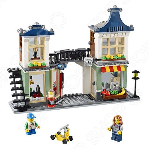 Конструктор LEGO Магазин по продаже игрушек и продуктовКонструкторы LEGO<br>Конструктор Lego Магазин по продаже игрушек и продуктов станет отличным подарком для юного конструктора, ведь предоставляет несколько различных вариантов строительства! Уютный магазинчик продает продукты и утренние газеты, а совсем рядом находится магазин игрушек. Универсам можно разложить, чтобы получить доступ к детально выполненному интерьеру, а можно сделать цветной фасад, выходящий на главную улицу. Кроме того, балкон магазина по продаже игрушек и продуктов превращается в изящный соединительный мостик, связывающий уютные квартиры на втором этаже. Набор отлично подходит для сюжетно-ролевых игр и позволяет ребенку выдумывать разнообразные истории, используя всю силу воображения. Все детали выполнены из высококачественных полимерных материалов, поэтому полностью безопасны для ребенка.<br>
