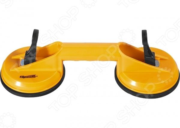 Стеклодомкрат двойной SPARTA 875155Стеклодомкраты<br>Стеклодомкрат двойной SPARTA 875155 приспособление, используемое для удобства транспортировки и установки оконных стекол и стеклопакетов. Он надежно крепится к гладкой поверхности стекла при помощи вакуумной присоски и выполняет роль импровизированной ручки. Стеклодомкрат также можно использовать для работы с листовым металлом. Корпус инструмента выполнен из ударопрочного пластика.<br>