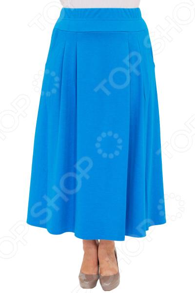 Юбка Матекс «Луина». Цвет: голубойЮбки<br>Юбка Матекс Луина прекрасная вещь для создания легкого женственного образа, которая идеально впишется в весенне-летний гардероб благодаря свободному крою и приятному материалу. Удобная юбка сделана из легкой ткани, поэтому прекрасно подойдет для повседневного использования.  Длинная юбка-клеш классического кроя.  Широкий пояс-резинка удобно сидит на талии и не ограничивает движений.  По бокам предусмотрено два кармана.  На фотографии модель представлена в сочетании с блузой Тутси . Юбка сшита из приятной на ощупь ткани 65 вискоза, 30 полиэстер, 5 лайкра . Материал не мнется, не скатывается и не линяет, быстро высыхает после стирки.<br>