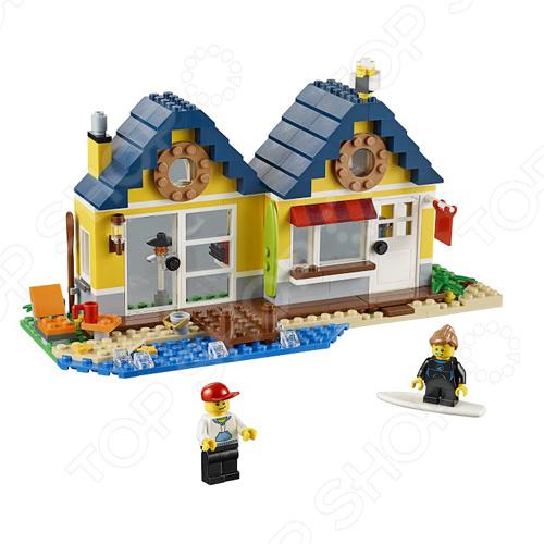 Конструктор LEGO Домик на пляжеКонструкторы LEGO<br>Конструктор Lego Домик на пляже станет отличным подарком для юного конструктора, ведь в наборе есть все необходимое для постройки настоящего домика, причем домиков предусмотрено аж три разных варианта! Тут можно собирать морских звезд, попробовать различные бодрящие напитки и даже заняться серфингом. Комплект содержит две фигурки, детали для постройки домика с открывающейся дверцей и различные аксессуары. Набор отлично подходит для сюжетно-ролевых игр и позволяет ребенку выдумывать разнообразные истории, используя всю силу воображения. Все детали выполнены из высококачественных полимерных материалов, поэтому полностью безопасны для ребенка.<br>