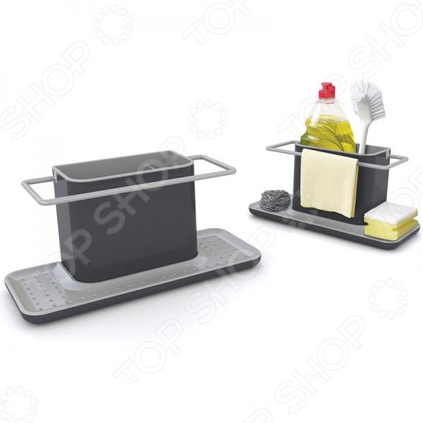 Органайзер для раковины Joseph Joseph Caddy - незаменимая вещь в любой ванной комнате. Такое приспособление позволит организовать рабочее пространство вокруг ванны и избавить, раз и навсегда, от бесконечного числа различных тряпочек, губочек, баночек, которые скапливаются на раковине. Органайзер быстро справится с беспорядком и расставит все принадлежности по своим места. Подставка имеет специальную платформу, которая подходит для хранения губок. Жидкость с них будет стекать вниз в специальный отсек, который потом очень легко отмыть. Круговая ручка - прекрасный держатель для маленьких тряпочек и полотенец. Два отделения позволяют сложить все необходимые предметы так, чтобы их можно было легко достать в случае необходимости.
