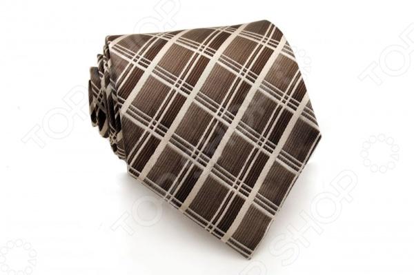 Галстук Mondigo 44271Галстуки. Бабочки. Воротнички<br>Галстук Mondigo 44271 - стильный мужской галстук ручной работы, выполненный из шелка, который обладает хорошими гигиеническими свойствами и особым блеском. Галстук карамельного цвета, украшен тонкими диагональными полосками. Края галстука обработаны лазерным методом. На обратной стороне галстука находится простроченная шелковая нитка, которая позволяет регулировать длину изделию. Такой стильный галстук будет очаровательно смотреться с мужскими рубашками светлых оттенков. Необычный дизайн дополнит деловой стиль и придаст изюминку к образу строгого делового костюма.<br>