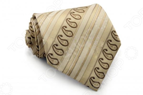 Галстук Mondigo 33331Галстуки. Бабочки. Воротнички<br>Галстук - важный элемент гардероба в жизни каждого мужчины. Сегодня сложно себе представить современного делового мужчину без галстука и это не удивительно, ведь именно галстук является главным атрибутом делового стиля. Не редко, для делового мужчины галстук - одна из немногих деталей, которая позволяет выразить свою индивидуальность, особенно в случаях, когда необходимо соблюдать строгий дресс-код. Однако, галстук уже давно вышел за пределы деловой сферы. Сегодня многие мужчины предпочитающие стиль кэжуал, так же активно прибегают к помощи различных галстуков для создания своего уникального образа. Галстуки стали очень разнообразными как по виду и цвету, так и по форме и материалу изготовления, благодаря этому их можно активно носить не только в офис и на деловых встречах, но даже на отдыхе и в повседневной жизни. Галстук Mondigo 33331 - оригинальная модель, которая станет завершающим штрихом в образе солидного мужчины. Правильно подобранный галстук позволяет эффектно выделить выбранный вами стиль, подчеркнуть изысканность и уникальность его владельца. Стильный мужской галстук горчичного цвета из 100 микрофибры, украшен фактурными полосками и узором пейсли по диагонали. Ширина у основания 8,5 см.<br>