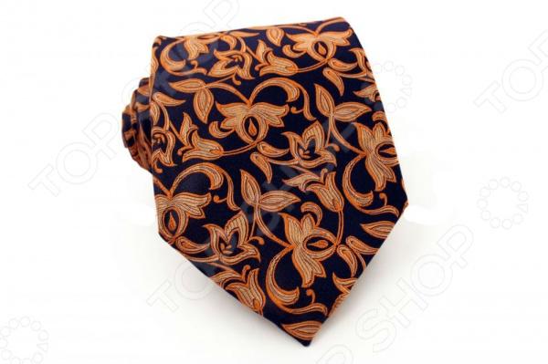 Галстук Mondigo 41013Галстуки. Бабочки. Воротнички<br>Галстук Mondigo 41013 это галстук из 100 шелка, украшен необычным цветочным принтом, края обработаны лазерным методом, с обратной стороны прострочен шелковой ниткой для регулировки длины изделия. Он подходит как для повседневной одежды, так и для эксклюзивных костюмов. Подберите галстук в соответствии с остальными деталями одежды и вы будете выглядеть идеально! В современном мире все большее распространение находит классический стиль одежды вне зависимости от типа вашей работы. Даже во время отдыха многие мужчины предпочитают костюм и галстук, нежели джинсы и футболку. Если вы хотите понравится девушке, то удивить ее своим стилем это проверенный метод от голливудских знаменитостей. Для того, чтобы каждый день выглядеть по-новому нет необходимости менять галстуки, можно сменить вариант узла, к примеру завязать:  узким восточным узлом, который подойдет для деловых встреч;  широким узлом Пратт , который прекрасно смотрится как на работе, так и во время отдыха;  оригинальным узлом Онассис , который удивит всех ваших знакомых своей неповторимый формой.<br>