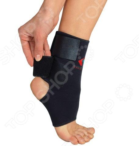 Повязка медицинская фиксирующая Tonus Elast для фиксации голеностопного сустава на липучке 0310Бандажи. Медицинские повязки<br>Tonus Elast 0310 это медицинская повязка, предназначенная для эффективной фиксации голеностопного сустава. Она оснащена липучкой и ее можно использовать для закрепления бинтовых повязок. Представленная модель используется в качестве лечебно-профилактического средства для защиты и поддержания в состоянии покоя связочного аппарата и мягких тканей сустава. Изделие изготовлено из неопрена, который обладает целым рядом уникальных свойств. Этот материал оказывает тепловое, микромассажное и компрессионное действие, сравнимое с живительным эффектом сауны.<br>