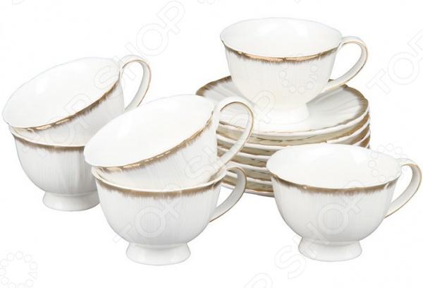Чайный сервиз Rosenberg 8706Чайные и кофейные наборы<br>Чайный сервиз Rosenberg 8706 это симпатичный чайный набор, который станет прекрасным подарком на любой праздник: свадьбу, день рожденья, юбилей или новоселье. Набор выполнен из высококачественного материала, который отличается повышенной износостойкостью и украшен красивым декоративным рисунком. Такой набор станет украшением любого повседневного стола. Комплект поставляется в подарочной коробке, в комплекте 12 предметов:  чашка: 150 мл;  блюдце 13,6х13,6 см.<br>