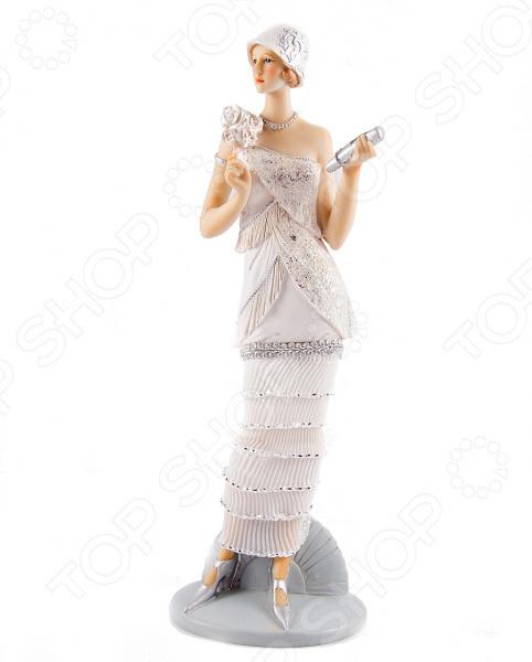 Статуэтка «Мисс Обаяние»Статуэтки и фигурки<br>Статуэтка Мисс Обаяние изысканный декоративный элемент для вашего дома. Изделие поможет внести завершающий штрих в интерьер любой комнаты, ведь уют складывается из мелочей. Эта статуэтка также может быть использована при сервировке праздничного стола в качестве декоративной составляющей. Кроме того, если вы желаете подобрать памятный подарок близкому человеку, то эта милая вещица прекрасно подойдет. Статуэтка выполнена из полистоуна. Это искусственный камень, сочетающий в себе массу полезных свойств. Материал экологичен, он абсолютно безопасен для человека и окружающей среды. Полистоун нейтрален к воздействию влаги и воздуха, а также слабых щелочных растворов; не впитывает запахи и влагу; устойчив к воздействию пищевых красителей. Материал не требует особого ухода, достаточно регулярно удалять пыль сухой мягкой тканью.<br>