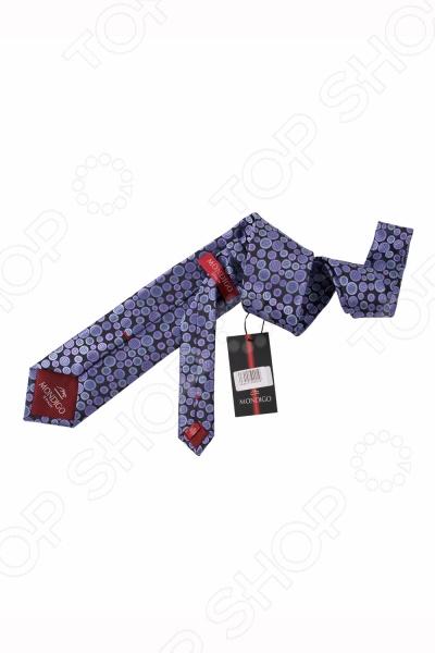 Галстук Mondigo 34155Галстуки. Бабочки. Воротнички<br>Галстук Mondigo 34155 представляет собой классическую модель галстука ручной работы из микрофибры и может похвастаться высоким качеством материала. С обратной стороны галстук скреплен шелковой ниткой, что позволяет регулировать длину изделия. Также солидность и качество галстука покажет и эмблема компании с внутренней стороны. Модель послужит прекрасным дополнением костюма и будет гармонично смотреться как в офисе, так и на официальных торжественных мероприятиях. Ширина у основания галстука составляет 7 см.<br>