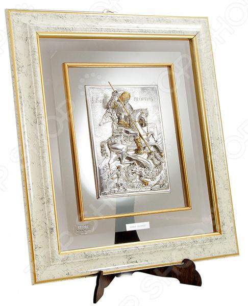 Картина Brunel «Георгий Победоносец» 259705Картины. Панно<br>Картина Brunel Георгий Победоносец 259705 это оригинальный и стильный аксессуар, который станет украшением вашего интерьера. Картины, постеры или настенные композиции являются классическим приемом декорирования комнат или коридоров. Размещенные в нужных местах, они могут помочь расставить акценты или подчеркнуть некоторые элементы внутреннего убранства. Модель с серебряным покрытием украсит комнату, добавит изысканности и шарма, а также подчеркнет утонченный вкус хозяина дома. Такой элемент декора не останется незамеченным гостями и станет отличным решением для любого помещения. Картина Brunel Георгий Победоносец 259705 может стать замечательным подарком или сувениром для ваших друзей и близких. Правила ухода: регулярно вытирать пыль сухой, мягкой тканью.<br>