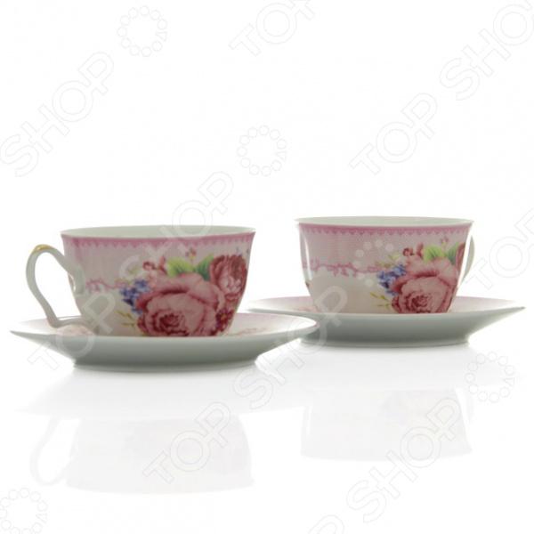 Чайная пара Loraine LR-24590 «Розы»Чайные и кофейные пары<br>Сервировка чайного столика не менее важна, чем сервировка основного праздничного стола, ведь качественная и красивая посуда позволит не только в полной мере насладиться напитком, но и получить эстетическое удовольствие от самого чаепития. Элегантный и красивый чайный набор Loraine LR-24590 Розы рассчитан на 2 персоны, поэтому он будет уместно смотреться, как на романтических встречах за чашечкой чая или кофе, так и на дружеских посиделках. Аккуратные чашечки и блюдца выполнены из высококачественной керамики. Однако несмотря на свою внешнюю хрупкость, они отличаются прочностью, легкостью, практичностью и эстетичностью. Они легко справляются с высокими температурами, а качественное покрытие не позволит внутренней стороне потемнеть, даже если вы предпочитаете очень крепкий чай или кофе. Нежный дизайн с очаровательным цветочным рисунком является дополнительным преимуществом этой чайной пары, которое оценят даже самые взыскательные ценители стиля и красоты. Чайный набор Loraine LR-24590 Розы станет идеальным и незаменимым подарком, который по достоинству оценят ваши друзья и близкие! Набору пакован в подарочную коробку, с внутренней части задрапированной белым атласом.<br>