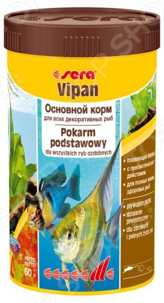 Корм для декоративных рыб Sera VipanВитамины и добавки. Корм для рыб<br>Корм для декоративных рыб Sera Vipan это основной корм, который подходит для ежедневного употребления в рацион ваших любимых аквариумных рыбок. Этот корм универсален, ведь он состоит из хлопьев, которые произведены путем бережной обработки сырья и подходит для всех видов рыб, которые кормятся у поверхности воды. После того, как рыбы насытятся, вам не придется очищать аквариум от избытка корма, ведь хлопья долго сохраняют свою форму и плавают на поверхности, их довольно скоро съедят более голодные рыбки.<br>