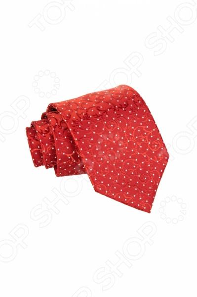 Галстук Mondigo 34903Галстуки. Бабочки. Воротнички<br>Галстук Mondigo 34903 станет важным дополнением гардероба каждого мужчины, ведь стильный и правильно подобранный галстук способен превратить повседневный классический образ мужчины в стильный и современный образ делового человека. Галстук выполнен из высококачественной микрофибры красного цвета и украшен цветочным узором и маленьким горошком белого цвета. Модель послужит прекрасным дополнением костюма и будет гармонично смотреться как в офисе, так и на официальных торжественных мероприятиях. В комплекте с галстуком карманный платок размером 23х23 см. Ширина у основания галстука составляет 8,5 см.<br>