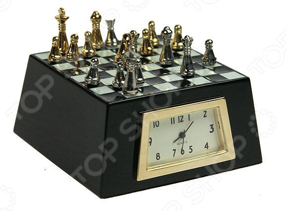 Часы настольные «Шахматы» 22428Часы настольные<br>Часы настольные Шахматы 22428 оригинально выполненные часы, украшенные декоративными элементами, станут прекрасным дополнением комнаты или офиса. Часы преобразят интерьер и придадут особую атмосферу. Имеют кварцевый механизм. Работают от батареек типа SR626 в комплект не входят . Рекомендуется регулярно удалять пыль сухой, мягкой тканью.<br>