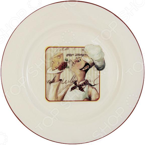 Тарелка обеденная Terracotta «Шеф-повар»Обеденные тарелки<br>Изящество и универсальность Тарелка обеденная Terracotta Шеф-повар идеально подходит для сервировки как праздничного застолья, так и ужина в тихом и уютном домашнем кругу. Представленную модель также можно использовать в качестве сервировочной посуды в местах общественного питания. Вы можете подать в тарелке салат, соленья или закуску. Современный стиль, интересный рисунок и универсальная цветовая гамма изделия придадут вашему ужину еще большей гармонии, эмоциональной наполненности и добавят нотку романтичности.  Оцените преимущества тарелки от бренда Terracotta:  Изготовлена из прочных и устойчивых к высоким температурам материалов.  Покрыта глазурью.  Имеет интересный дизайн и универсальна в применении.  Превосходно впишется в интерьер кухни и столовой.  Подходит для разогревания пищи в духовом шкафу или микроволновой печи.  Может использоваться для хранения продуктов в холодильнике.  Подойдет в качестве подарка для ваших любимых, родных и близких. Посуда от бренда Terracotta изготавливается на новейшем оборудовании и при строгом контроле на всех этапах производственного процесса. В качестве основного материала используется покрытая глазурью жаропрочная керамика. Этот материал издавна вошел в обиход человека, ведь его главными свойствами являются натуральность и экологичность. Правила ухода. Рекомендуется мыть теплой водой с небольшим количеством моющих средств. Допускается мытье в посудомоечной машине при соблюдении инструкции изготовителя посудомоечной машины. Не использовать абразивные пасты и металлические мочалки.<br>