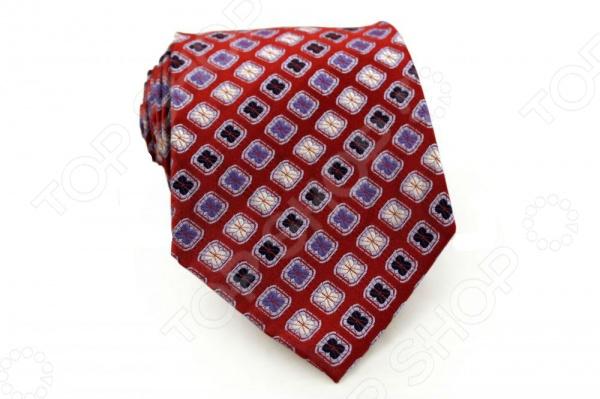 Галстук Mondigo 44506Галстуки. Бабочки. Воротнички<br>Галстук Mondigo 44506 это галстук из 100 шелка, украшен абстрактным принтом, а с другой стороны галстук прострочен шелковой ниткой. Он подходит как для повседневной одежды, так и для эксклюзивных костюмов. Подберите галстук в соответствии с остальными деталями одежды и вы будете выглядеть идеально! В современном мире все большее распространение находит классический стиль одежды вне зависимости от типа вашей работы. Даже во время отдыха многие мужчины предпочитают костюм и галстук, нежели джинсы и футболку. Если вы хотите понравится девушке, то удивить ее своим стилем это проверенный метод от голливудских знаменитостей. Для того, чтобы каждый день выглядеть по-новому нет необходимости менять галстуки, можно сменить вариант узла, к примеру завязать:  узким восточным узлом, который подойдет для деловых встреч;  широким узлом Пратт , который прекрасно смотрится как на работе, так и во время отдыха;  оригинальным узлом Онассис , который удивит всех ваших знакомых своей неповторимый формой.<br>