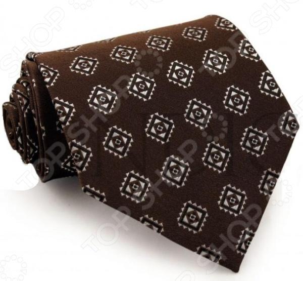 Галстук Mondigo 33324Галстуки. Бабочки. Воротнички<br>Галстук Mondigo 33324 это галстук из микрофибры, который украшен оригинальным этническим принтом. Он подходит как для повседневной одежды, так и для эксклюзивных костюмов. Подберите галстук в соответствии с остальными деталями одежды и вы будете выглядеть идеально! В современном мире все большее распространение находит классический стиль одежды вне зависимости от типа вашей работы. Даже во время отдыха многие мужчины предпочитают костюм и галстук, нежели джинсы и футболку. Если вы хотите понравится девушке, то удивить ее своим стилем это проверенный метод от голливудских знаменитостей. Для того, чтобы каждый день выглядеть по-новому нет необходимости менять галстуки, можно сменить вариант узла, к примеру завязать:  узким восточным узлом, который подойдет для деловых встреч;  широким узлом Пратт , который прекрасно смотрится как на работе, так и во время отдыха;  оригинальным узлом Онассис , который удивит всех ваших знакомых своей неповторимый формой.<br>