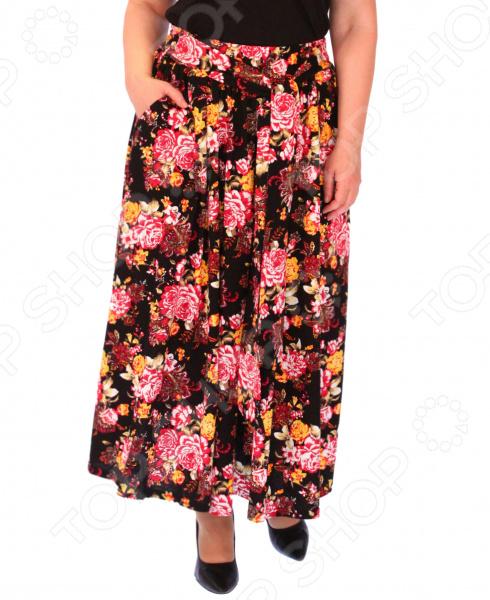 Юбка Матекс «Цветочный карнавал»Юбки<br>Юбка Матекс Цветочный карнавал прекрасная вещь для создания легкого женственного образа, которая идеально впишется в весенне-летний гардероб благодаря свободному крою и приятному материалу. Удобная юбка сделана из легкой ткани, поэтому прекрасно подойдет для повседневного использования.  Юбка фасона солнце с удобным поясом на широкой резинке.  Предусмотрено два небольших боковых кармана.  Юбка сшита из легкой хлопковой ткани с незначительным добавлением полиэстера для прочности. Материал превосходно пропускает воздух, не линяет, не скатывается, формы от стирки не теряет.<br>