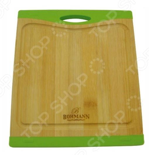 Доска разделочная Bohmann ВН-02Разделочные коврики и доски<br>Доска разделочная Bohmann ВН-02 это традиционная доска из бамбука, которая является незаменимым предметом кухонной утвари. Бамбук представляет из себя прочный и гибкий материал, который легко выдерживает ежедневные нагрузки в виде нарезки мяса, рыбы, и овощей. Кроме того, доска из этого материала экологически чистая и не оставит вредных частиц на пище. Для уверенности в чистоте продуктов на вашей кухне стоит использовать несколько досок для каждого вида пищи, отдельную для рыбы, овощей, мясных изделий и прочего.<br>