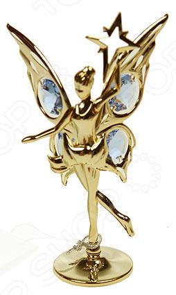 Фигурка декоративная Crystocraft «Балерина» с кристаллами Swarovski 67460Статуэтки и фигурки<br>Фигурка декоративная Crystocraft Балерина с кристаллами Swarovski 67460 оригинальный сувенир, который восхитит вас своей утонченностью и изяществом. Такая милая фигурка станет прекрасным украшением любого интерьера, она обязательно найдет свое место на полке в гостиной или на вашем рабочем столе. Сувенир выполнен из углеродистой стали этот материал прочен, но вместе с тем создает ощущение легкости и воздушности. Фигурка представлена в красивейшей золотистой расцветке, которая добавляет ей особые нотки очарования и роскоши. А настоящие кристаллы Swarovski станут предметом вашего нескончаемого восхищения. Если вы находитесь в поисках подходящего подарка для друга, коллеги или родственника, то декоративная фигурка с кристаллами это то, что вам нужно. Изящный сувенир станет достойным знаком внимания для любого праздника, поможет высказать виновнику торжества все положительные эмоции и расскажет о вашем утонченном, изысканном вкусе.<br>