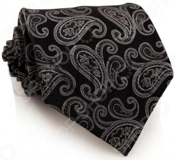 Галстук Mondigo 44214Галстуки. Бабочки. Воротнички<br>Галстук Mondigo 44214 завершающий штрих в образе солидного мужчины. Сегодня классический стиль в одежде приветствуется не только на работе в офисе. Многие люди предпочитают в качестве повседневной одежды костюм или рубашку с галстуком. Мужчина, выбирающий такой стиль в одежде, всегда выделяется среди окружающих и производит положительное первое впечатление. Кроме того, один и тот же галстук можно носить по-разному каждый день. Достаточно выбрать один из многочисленных типов узлов: аскот, балтус, кент, пратт и многие другие. Кстати, в интернете есть сайты, которые случайным образом предлагают вариант узла удобно, когда трудно определиться с выбором . Галстук изготовлен из шелка. Ткань довольно прочная, приятная на ощупь и отличается роскошным блеском. С обратной стороны галстук прострочен шелковой ниткой, что позволяет регулировать длину изделия.<br>