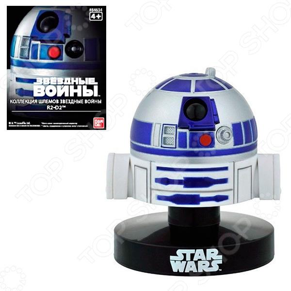 Шлем супер-героя Bandai R2-D2Шлемы, маски и аксессуары героев мультфильмов и комиксов<br>Шлем супер-героя Bandai R2-D2 это миниатюрная копия головы робота R2-D2 из знаменитой саги Звездные войны . Высота модели 6,5 сантиметров. Такую фигурку оценят и дети-поклонники саги, и взрослые, которые увлекаются коллекционированием. Фигурка Bandai выполнена из высококачественных материалов, лицензирована фирмами правообладателями и характеризуется высоким качеством исполнения.<br>