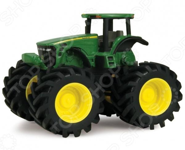 Машинка игрушечная Tomy «Трактор» Monster TreadsМашинки<br>Машинка игрушечная Tomy Трактор Monster Treads это реалистичная копия настоящего спец.транспорта. Представленная модель даст юному автомобилисту почувствовать себя настоящим фермером. Большие прорезиненные колеса с протектором не царапают напольное покрытие и не оставляют следов. Игра на детской площадке или в песочнице с таким трактором надолго займет малыша и не даст ему заскучать. Машинка игрушечная Tomy Трактор Monster Treads изготовлена из металла и обладает отличной детализацией. Яркая машина разнообразит игровые ситуации, откроет новые сюжеты для маленького автолюбителя и поможет развить мелкую моторику рук, логическое мышление и воображение. Не упустите шанс порадовать ребенка замечательным подарком!<br>