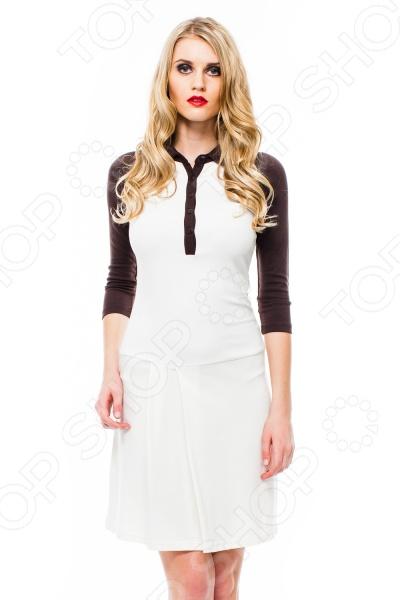 Платье Mondigo 8668. Цвет: молочныйПовседневные платья<br>Ни для кого не секрет, что мужчины гораздо чаще обращают внимание на женщин в платье, нежели на особ в джинсах и рубашках. И это не удивительно, ведь именно платье является исключительно женским предметом гардероба. Брюки, джинсы, рубашки и свитера женщины делят с сильной половиной человечества, даже юбки не являются исключительно женской вещью. Но только не платье! Платье безраздельно принадлежит женщине. Именно оно является самым важным элементом в гардеробе каждой модницы. Платье дарит ощущение женственности, выгодно подчеркивая изящные линии фигуры, делая свою обладательницу более изящной и женственной или строгой и сексуальной. Современная модная индустрия предлагает платья на любой вкус и фигуру, для любого времени года и события, остается только выбрать то, что подойдет именно вам. Платье Mondigo 8668 - оригинальная полуспортивная модель длинной выше колена и рукавом реглан длинной 3 4. Платье отрезное ниже линии талии. Горловина оформлена в виде отложного воротничка с застежкой-поло. Полочка на юбке оформлена 2 складками. Воротник, рукава и планка застежки выполнены в контрастном цвете. Удобное и практичное платье - отличный вариант для прогулок и встреч.<br>