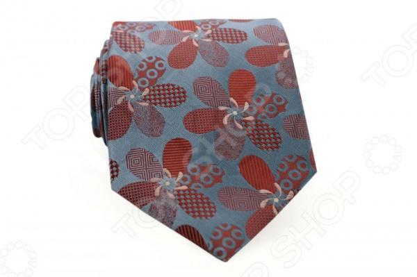Галстук Mondigo 33190Галстуки. Бабочки. Воротнички<br>Галстук Mondigo 33190 это галстук из высококачественной микрофибры, украшен цветочным рисунком с геометрическими мотивами. Он подходит как для повседневной одежды, так и для эксклюзивных костюмов. Подберите галстук в соответствии с остальными деталями одежды и вы будете выглядеть идеально! В современном мире все большее распространение находит классический стиль одежды вне зависимости от типа вашей работы. Даже во время отдыха многие мужчины предпочитают костюм и галстук, нежели джинсы и футболку. Если вы хотите понравится девушке, то удивить ее своим стилем это проверенный метод от голливудских знаменитостей. Для того, чтобы каждый день выглядеть по-новому нет необходимости менять галстуки, можно сменить вариант узла, к примеру завязать:  узким восточным узлом, который подойдет для деловых встреч;  широким узлом Пратт , который прекрасно смотрится как на работе, так и во время отдыха;  оригинальным узлом Онассис , который удивит всех ваших знакомых своей неповторимый формой.<br>