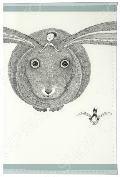 Обложка для паспорта кожаная Mitya Veselkov «Кролик летит»Обложки для паспортов<br>Mitya Veselkov Кролик летит это современная и ультрамодная обложка для вашего паспорта. Украшенная дизайнерским принтом с внешней стороны модель, предназначена для людей, которые хотят сделать жизнь ярче, красочней, а к традиционным вещам подходят творчески. Изделие подходит как для внутреннего, так и заграничного удостоверения личности. Изготовленная из натуральной кожи обложка, надежно защитит важный документ от внешнего воздействия, поэтому он всегда будет как новый. Придайте паспорту оригинальности и подчеркните свою уникальность!<br>