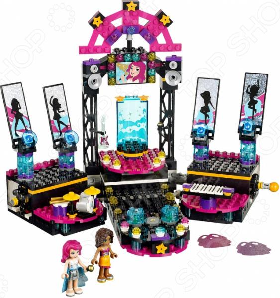 Конструктор игровой LEGO «Поп звезда: сцена»Конструкторы LEGO<br>Конструктор игровой Lego Поп звезда: сцена обязательно понравится ребенку. Он сможет самостоятельно собрать целую композицию, с которой потом можно будет играть. Играя с конструктором, ребенок будет развивать пространственное и логическое мышление, творческие способности и мелкую моторику рук. Кроме того, с получившейся игрушкой он сможет самостоятельно придумывать различные игровые ситуации, развивая тем самым и фантазию. В комплект поставки также входят две мини-фигурки с аксессуарами Ливи и Андреа .<br>