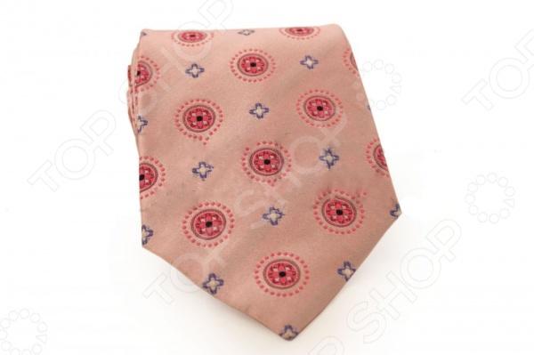 Галстук Mondigo 44287Галстуки. Бабочки. Воротнички<br>Галстук Mondigo 44287 это галстук из 100 шелка, края обработаны лазерным методом, а с обратной стороны он прострочен шелковой ниткой. Он подходит как для повседневной одежды, так и для эксклюзивных костюмов. Подберите галстук в соответствии с остальными деталями одежды и вы будете выглядеть идеально! В современном мире все большее распространение находит классический стиль одежды вне зависимости от типа вашей работы. Даже во время отдыха многие мужчины предпочитают костюм и галстук, нежели джинсы и футболку. Если вы хотите понравится девушке, то удивить ее своим стилем это проверенный метод от голливудских знаменитостей. Для того, чтобы каждый день выглядеть по-новому нет необходимости менять галстуки, можно сменить вариант узла, к примеру завязать:  узким восточным узлом, который подойдет для деловых встреч;  широким узлом Пратт , который прекрасно смотрится как на работе, так и во время отдыха;  оригинальным узлом Онассис , который удивит всех ваших знакомых своей неповторимый формой.<br>