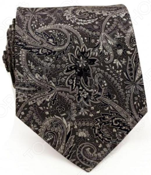 Галстук Mondigo 44175Галстук Mondigo 44175 завершающий штрих в образе солидного мужчины. Сегодня классический стиль в одежде приветствуется не только на работе в офисе. Многие люди предпочитают в качестве повседневной одежды костюм или рубашку с галстуком. Мужчина, выбирающий такой стиль в одежде, всегда выделяется среди окружающих и производит положительное первое впечатление. Кроме того, один и тот же галстук можно носить по-разному каждый день. Достаточно выбрать один из многочисленных типов узлов: аскот, балтус, кент, пратт и многие другие. Кстати, в интернете есть сайты, которые случайным образом предлагают вариант узла удобно, когда трудно определиться с выбором . Галстук изготовлен из шелка. Ткань довольно прочная, приятная на ощупь и отличается роскошным блеском. С обратной стороны галстук прострочен шелковой ниткой, что позволяет регулировать длину изделия.<br>