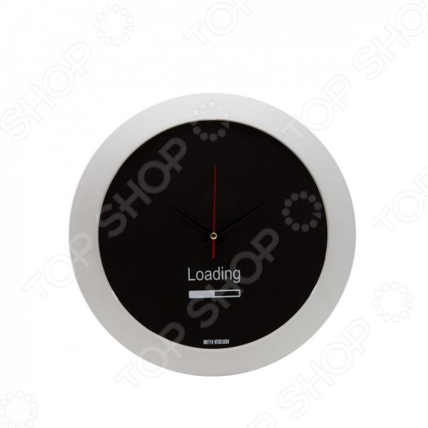 Часы настенные Mitya Veselkov LoadingЧасы настенные<br>Настенные часы это элегантный и неотъемлемый элемент дизайна любого помещения. Правильно подобранные часы позволяют внести в общий интерьерный ансамбль некоторую изюминку и легкий штрих индивидуальности, собственного стиля. Поэтому к подбору такого значимого и функционального украшения надо подходить с умом. Настенные часы от отечественного бренда Mitya Veselkov станут настоящей находкой для тех, кто следит за трендами современной моды, любит постоянные перемены и предпочитает новаторские решения взамен обыденной классике. Часы настенные Mitya Veselkov Loading отлично впишутся в интерьер вашей гостиной, спальни, кухни или детской комнаты. Корпус кварцевых часов выполнен из качественного пластика, который гарантирует не только их легкость, но и практичность, легкий монтаж и уход. Циферблат данной модели отличается оригинальным дизайном, который придется по душе поклонникам современного искусства. Создайте неповторимую атмосферу уюта и комфорта с необычными настенными часами Mitya Veselkov Loading!<br>