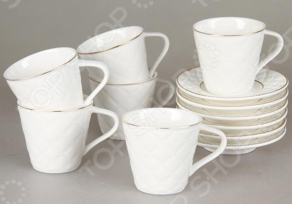 Кофейный набор Rosenberg 8711Чайные и кофейные наборы<br>Набор кофейный Rosenberg 8711 оригинальный набор великолепно выполненных предметов для распития напитков. Набор состоит из 6 небольших, оригинально декорированных чашек, которые прекрасно подойдут для организации кофейной церемонии. Также подойдет как подарок на свадьбу молодоженам. Чашки изготовлены из качественного материала. Все чашки располагаются на своём блюдце. Размер блюдца 10.5х10.5 см. Красивое оформление стола как праздничного, так и повседневного это целое искусство. Правильно подобранная посуда это залог успеха в этом деле.<br>