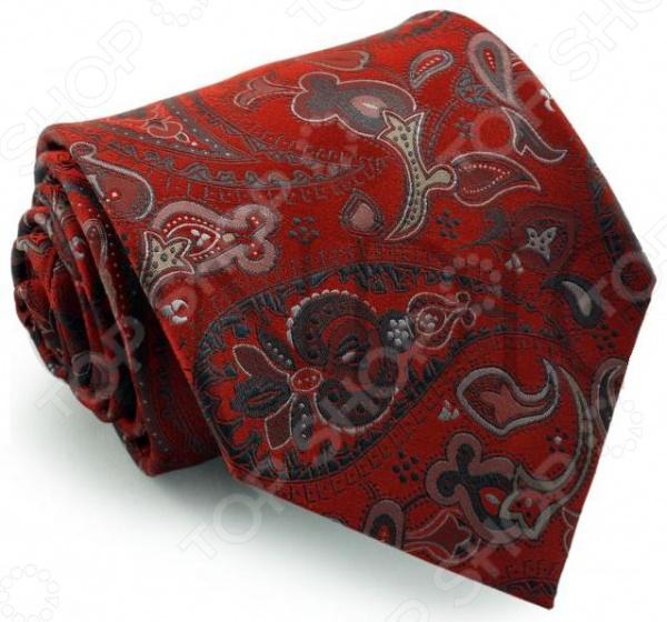Галстук Mondigo 44061Галстуки. Бабочки. Воротнички<br>Галстук Mondigo 44061 завершающий штрих в образе солидного мужчины. Сегодня классический стиль в одежде приветствуется не только на работе в офисе. Многие люди предпочитают в качестве повседневной одежды костюм или рубашку с галстуком. Мужчина, выбирающий такой стиль в одежде, всегда выделяется среди окружающих и производит положительное первое впечатление. Кроме того, один и тот же галстук можно носить по-разному каждый день. Достаточно выбрать один из многочисленных типов узлов: аскот, балтус, кент, пратт и многие другие. Кстати, в интернете есть сайты, которые случайным образом предлагают вариант узла удобно, когда трудно определиться с выбором . Галстук изготовлен из шелка. Ткань довольно прочная, приятная на ощупь и отличается роскошным блеском.<br>
