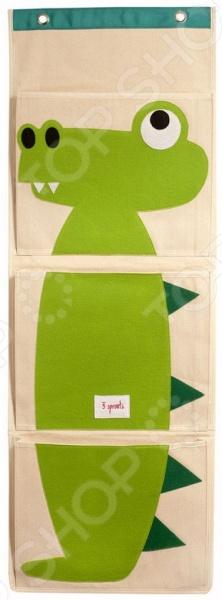 Органайзер на стену 3 Sprouts «Крокодил»Хранение игрушек<br>Органайзер на стену 3 Sprouts Крокодил практичное и стильное решение для детской комнаты. Оригинальный органайзер позволит вам легко организовать хранение всех игрушек и прочих детских мелочей. В нем вы сможете с комфортом расположить небольшие детские книжки, блокноты и рисунки, письменные принадлежности и прочие мелочи. Всего имеется три вместительных кармашка, украшенных оригинальными аппликациями в виде большого зеленого крокодила. Пока малыш не вырос в таком органайзере можно хранить подгузники или другие косметические средства по уходу за ребенком. Благодаря практичной подвесной конструкции, аксессуар можно расположить на стене рядом с кроваткой или на двери.<br>